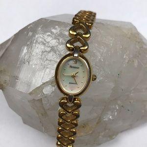Armitron gold heart watch quartz mother of pearl